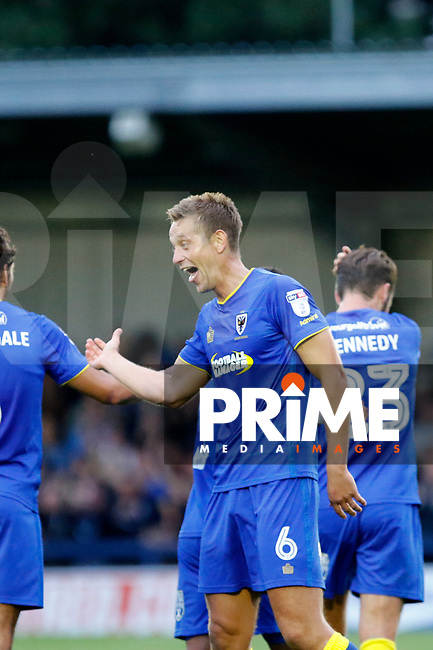 GOAL - AFC Wimbledon's Paul Robinson is congratulated after scoring during the Carabao Cup match between AFC Wimbledon and Brentford at the Cherry Red Records Stadium, Kingston, England on 8 August 2017. Photo by Carlton Myrie.