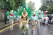 London, England. 31 August 2015. Performers from the Paraiso School of Samba setting up for the parade. Performers and revellers were in good spirits despite a second years of heavy rain on the Adult Day of Notting Hill Carnival. Photo: Bettina Strenske