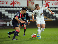 Pictured: Stephen Kingsley of Swansea (R) Monday 04 April 2016<br />