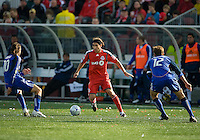 26 April 2009: Toronto FC forward Pablo Vitti #8 appears to be surrounded by Kansas City Wizards defender Jimmy Conrad #12 and Kansas City Wizards midfielder Santiago Hirsig #10 at BMO Field in Toronto in a  game between Kansas City Wizards and Toronto FC..Toronto FC won 1-0.