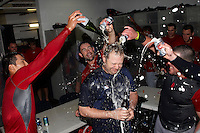 Pawtucket Red Sox strength and conditioning coach Doug Griswold is doused after game four of a best of five playoff series against the Empire State Yankees by Che-Hsuan Lin, Dan Butler and others at Frontier Field on September 8, 2012 in Rochester, New York.  Pawtucket defeated Empire State 7-1 to advance to the International League Finals.  (Mike Janes/Four Seam Images)