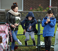 Pictured: A young woman and two boys gather to see Prince Charles at the Memorial Garden in Aberfan Friday 21 October 2016<br />