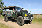 "Nick Carter in the 1964 amphibious air portable Land Rover Series 2a 109in ""APGP"" (Air Portable General Purpose). Dunsfold Collection of Land Rovers Open Day 2011, Dunsfold, Surrey, UK. --- No releases available, but releases may not be necessary for certain uses. Automotive trademarks are the property of the trademark holder, authorization may be needed for some uses. --- Vehicle Information: Belonging to the Dunsfold Collection of Land Rovers: Chassis Number 331000008A, Registration APB 963A, Engine 2.25 petrol 24 volt, Gearbox 4-speed. --- Vehicle History: This Land Rover is known as the A.P.G.P., Air Portable General Purpose. Based around a 1 Ton military spec 109 24 Volt, it has amphibious capabilities. This LR floats! A small propeller is mounted on the rear propshaft, the air bags were inflated from the exhaust. This was to be a multi role vehicle. The APGP can be a radio station, wombat carrier or 110 Volt power tool source and could be stacked two high for air transport. About 26 of these vehicles were built for troop trials in 1964 but never entered service. This is the first vehicle to find its way into the Dunsfold Collection, purchased in 1968 via Ruddington military auctions."
