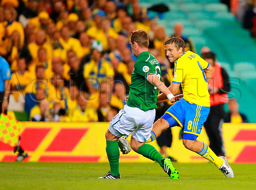06.09.2013 Dublin, Ireland. Anders Svensson (Sweden) slots the ball in the net to score during the 2014 World Cup Qualifier between Republic of Ireland and Sweden from the Aviva Stadium.