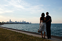 President Barack Obama and First Lady Michelle Obama look out at the Chicago, Ill., skyline, June 15, 2012. (Official White House Photo by Pete Souza)<br /> <br /> This official White House photograph is being made available only for publication by news organizations and/or for personal use printing by the subject(s) of the photograph. The photograph may not be manipulated in any way and may not be used in commercial or political materials, advertisements, emails, products, promotions that in any way suggests approval or endorsement of the President, the First Family, or the White House.