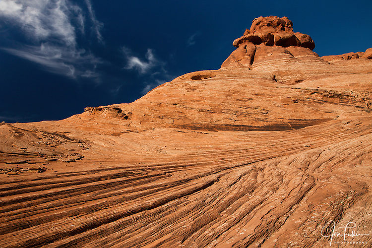 Swirling lines in the Navajo sandstone called cross-bedding on a rock formation in Arches National Park near Moab, Utah, USA.