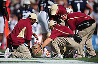 Sept. 19, 2009; Provo, UT, USA; Florida State Seminoles trainers tend to injured fullback Daniel Gard on the field against the BYU Cougars at LaVell Edwards Stadium. Florida State defeated BYU 54-28. Mandatory Credit: Mark J. Rebilas-