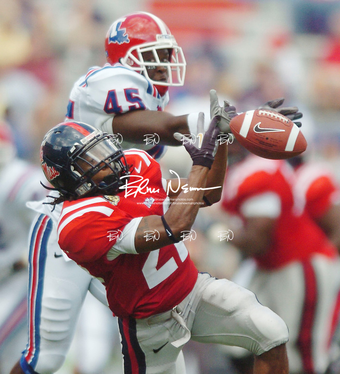 Mississippi's Dexter McCluster (22) is unable to make a catch as Louisiana Tech's Marquis McBeath (45) knocks it away Vaught-Hemingway Stadium in Oxford, Miss. on Saturday, October 6, 2007.