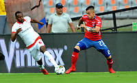 MEDELLIN-COLOMBIA, 10-03-2019: Leonardo Castro de Deportivo Independiente Medellín disputa el balón con Juan David Valencia de Independiente Santa Fe, durante partido de la fecha 9 entre Deportivo Independiente Medellín y el Independiente Santa Fe, por la Liga Águila I 2019, en el estadio Atanasio Girardot de la ciudad de Medellín. / Leonardo Castro of Deportivo Independiente Medellin fight for the ball with Juan David Valencia of Independiente Santa Fe, during a match for the 9th date between Deportivo Independiente Medellin and Independiente Santa Fe, for the Aguila Leguaje I 2019 at the Atanasio Girardot stadium in Medellin city. Photos: VizzorImage  / León Monsalve / Cont.