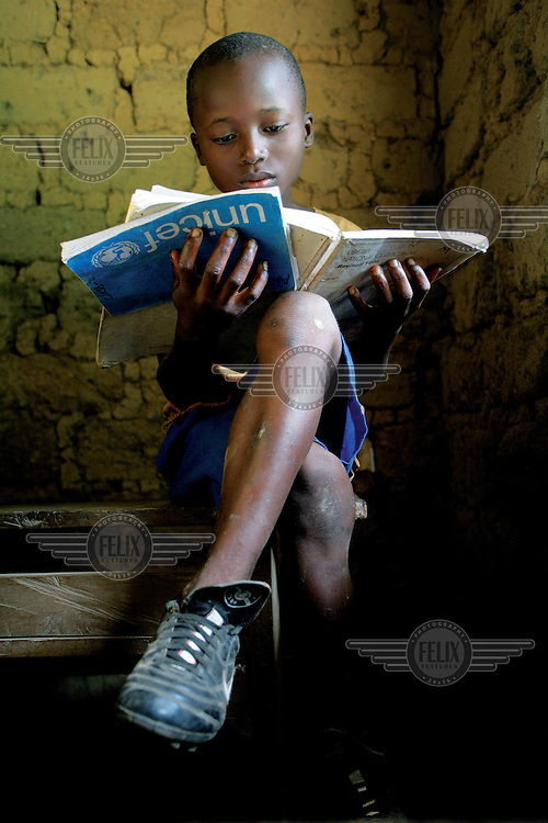 10 year old Patrick Tamba attends school after years lost to war..