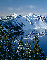 ORCL_012 - USA, Oregon, Crater Lake National Park, Winter snow on west rim of Crater Lake with The Watchman (left) and Hillman Peak (right).