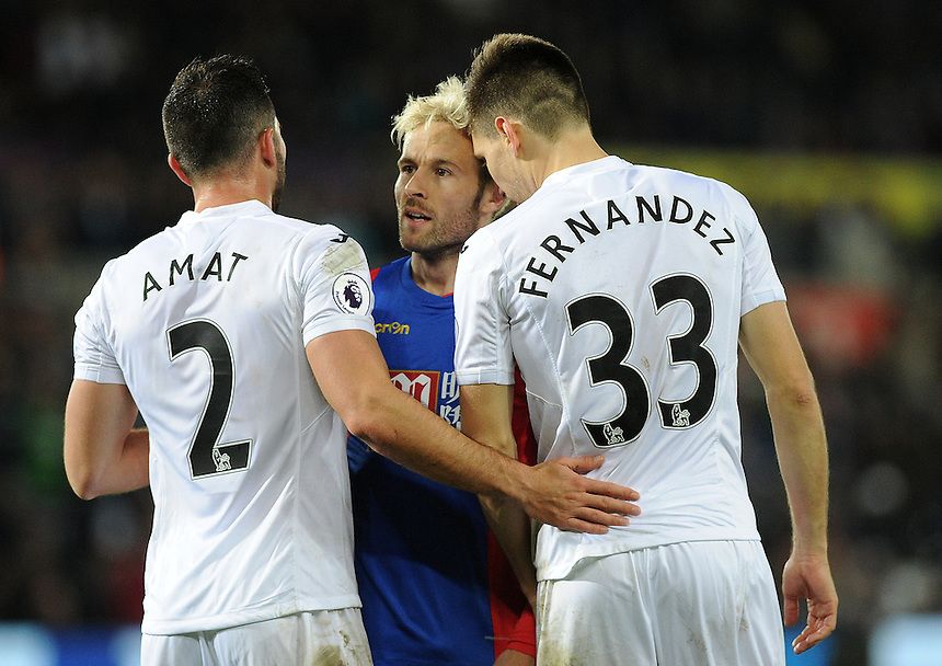 Crystal Palace's Yohan Cabaye exchanges words with Swansea City's Jordi Amat and Federico Fernandez<br /> <br /> Photographer Ashley Crowden/CameraSport<br /> <br /> The Premier League - Swansea City v Crystal Palace - Saturday 26th November 2016 - Liberty Stadium - Swansea <br /> <br /> World Copyright &copy; 2016 CameraSport. All rights reserved. 43 Linden Ave. Countesthorpe. Leicester. England. LE8 5PG - Tel: +44 (0) 116 277 4147 - admin@camerasport.com - www.camerasport.com
