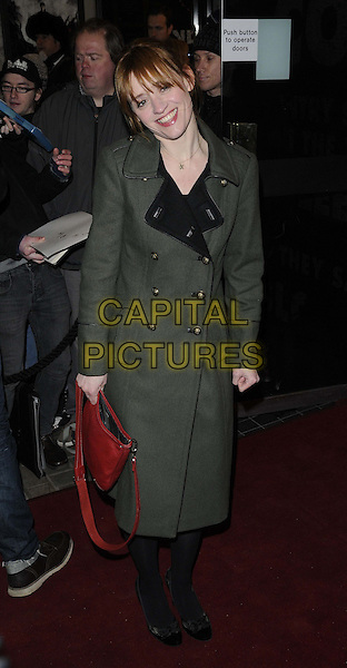 """Anne-Marie Duff.The """"Macbeth"""" press night performance, Trafalgar Studios, Whitehall, London, England..February 22nd, 2013.full length green military coat jacket gold buttons black tights red bag purse .CAP/CAN.©Can Nguyen/Capital Pictures."""