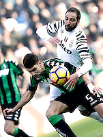 Calcio, Serie A: Sassuolo vs Juventus. Reggio Emilia, Mapei Stadium, 29 gennaio 2017. <br /> Sassuolo's Luca Antei, left, and Juventus' Gonzalo Higuain fight for the ball during the Italian Serie A football match between Sassuolo and Juventus at Reggio Emilia's Mapei stadium, 29 January 2017.<br /> UPDATE IMAGES PRESS/Isabella Bonotto