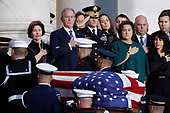 Former President George W. Bush, Laura Bush, left, and other family members watch as the flag-draped of former President George H.W. Bush is carried by a joint services military honor guard to lie in state in the rotunda of the U.S. Capitol, Monday, Dec. 3, 2018, in Washington. (AP Photo/Alex Brandon, Pool)