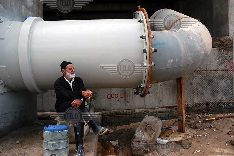 Worker at a petrochemical plant in the port of Mahshahr.