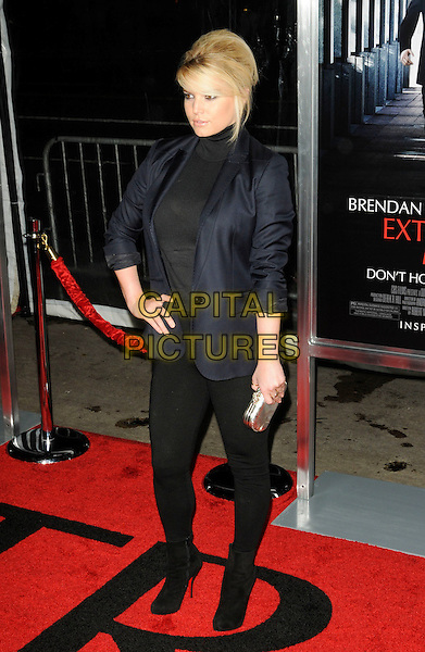 "JESSICA SIMPSON.arriving at the premiere of ""Extraordinary Measures"" at Grauman's Chinese Theatre in Hollywood, California, USA,   January 19th, 2010..arrivals full length black hand on hip blazer jacket polo neck top leggings silver clutch bag ankle boots sheer see top thru  through  bra navy blue .CAP/ROT.©Lee Roth/Capital Pictures"