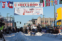 Allen Moore and team leave the ceremonial start line with an Iditarider and handler at 4th Avenue and D street in downtown Anchorage, Alaska on Saturday March 4th during the 2017 Iditarod race. Photo © 2017 by Brendan Smith/SchultzPhoto.com.