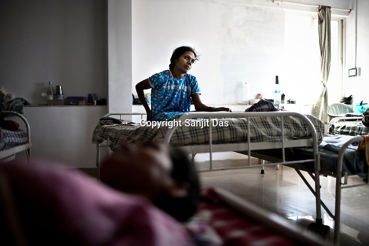 30 year old surrogate mother Saroj Machwan (right) seen at the Akanksha Infertility and IVF Clinic in Anand, Gujarat, India. The centre has become the most popular clinic for outsourcing pregnancies by western couples.