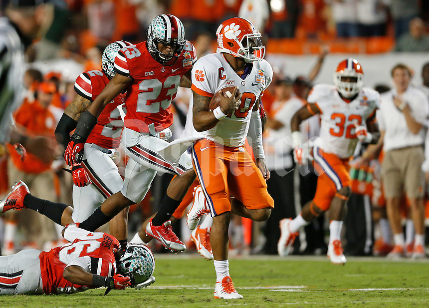 Clemson Tigers quarterback Tajh Boyd (10) breaks away from the Ohio State Buckeyes defense to rush for a touchdown in the first quarter of the Discover Orange Bowl between Ohio State and Clemson at Sun Life Stadium in Miami Gardens, Florida, Friday night, January 3, 2014. As of half time the Ohio State Buckeyes led the Clemson Tigers 22 - 20.(The Columbus Dispatch / Eamon Queeney)