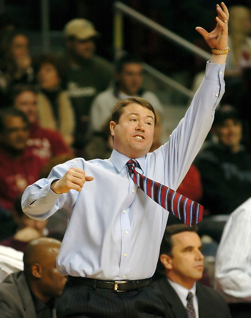 University of Massachusetts coach Travis Ford reacts to a play in first period action against Temple Sunday, Feb. 11, 2007 in Philadelphia. Temple beat University of Massachusetts 98-89. (AP Photo/Bradley C Bower)