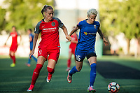 Seattle, WA - Saturday, July 1, 2017:  Megan Rapinoe and Dagný Brynjarsdóttir during a regular season National Women's Soccer League (NWSL) match between the Seattle Reign FC and the Portland Thorns FC at Memorial Stadium.
