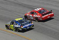 May 6, 2007; Richmond, VA, USA; Nascar Nextel Cup Series driver Dale Earnhardt Jr (8) races alongside Jimmie Johnson (48) during the Jim Stewart 400 at Richmond International Raceway. Mandatory Credit: Mark J. Rebilas