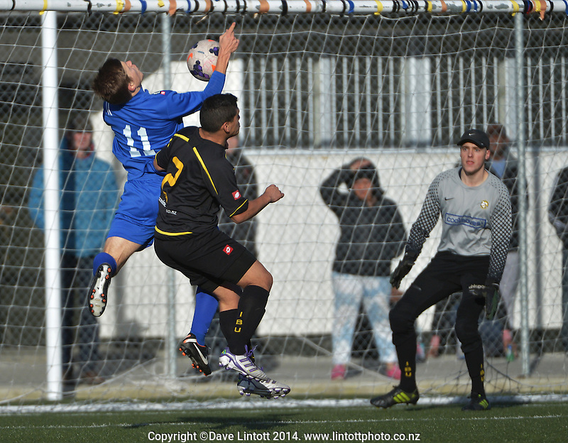 Action from the Chatham Cup football match between Island Bay and Napier City Rovers (blue) at Wakefield Park, Wellington, New Zealand on Sunday, 27 July 2014. Photo: Dave Lintott / lintottphoto.co.nz