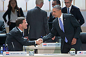"United States President Barack Obama, right, shakes hands with Mark Rutte, Dutch prime minister, during an opening plenary entitled ""National Actions to Enhance Nuclear Security"" at the Nuclear Security Summit in Washington, D.C., U.S., on Friday, April 1, 2016. After a spate of terrorist attacks from Europe to Africa, Obama is rallying international support during the summit for an effort to keep Islamic State and similar groups from obtaining nuclear material and other weapons of mass destruction. <br /> Credit: Andrew Harrer / Pool via CNP"