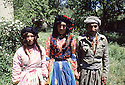 Iran 1981.A man and two women in traditional dress near Oushnavieh