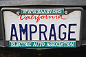 An 'AMPRAGE' (Electric Truck) license plate on an electric vehicle with an Electric Auto Association license plate frame. Amperage is the strength of a current of electricity. Electric Vehicle Rally in Palo Alto, California, USA