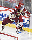 Nathan Gerbe 9 of Boston College goes flying into Jeff Likens 5 of the University of Wisconsin. The Boston College Eagles defeated the University of Wisconsin Badgers 3-0 on Friday, October 27, 2006, at the Kohl Center in Madison, Wisconsin in their first meeting since the 2006 Frozen Four Final which Wisconsin won 2-1 to take the national championship.<br />