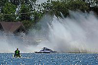 "Frame 4: Kevin Kreitzer, A-64 ""Blue Devil"" hooks in turn 2 and blows some decking off the boat. (2.5 MOD class hydroplane(s)"