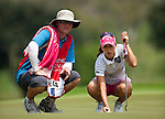 CHON BURI, THAILAND - FEBRUARY 18:  Momoko Ueda of Japan lines up a putt with her caddie on the 2nd green during day two of the LPGA Thailand at Siam Country Club on February 18, 2011 in Chon Buri, Thailand.  Photo by Victor Fraile / The Power of Sport Images