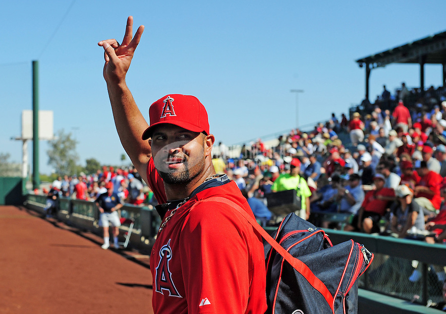 Mar. 6, 2012; Tempe, AZ, USA; Los Angeles Angels designated hitter Albert Pujols waves goodbye after leaving the game following a double in the fourth inning against the Chicago White Sox during a spring training game at Tempe Diablo Stadium.  Mandatory Credit: Mark J. Rebilas-