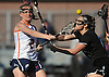 Erin Barry #2 of Manhasset, left, scores a goal during the first half of a Nassau County varsity girls lacrosse game against Long Beach at Manhasset High School on Friday, Apr. 15, 2016. Manhasset won by a score of 9-8.