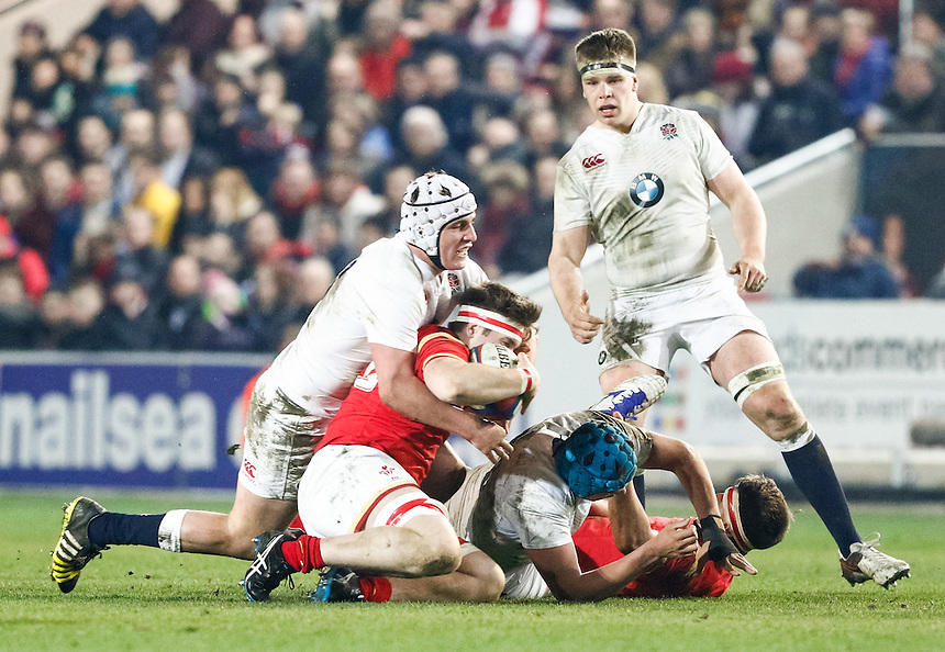 Wales U20's Morgan Sieniawski under pressure from England U20's Curtis Langdon<br /> <br /> Photographer Simon King/CameraSport<br /> <br /> International Rugby Union - RBS Under 20's Six Nations Championships 2016 Round 4 - England U20 v Wales U20 - Friday 11th March 2016 - Ashton Gate - Bristol<br /> <br /> &copy; CameraSport - 43 Linden Ave. Countesthorpe. Leicester. England. LE8 5PG - Tel: +44 (0) 116 277 4147 - admin@camerasport.com - www.camerasport.com