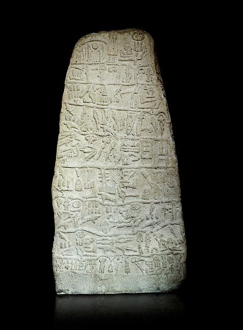 Neo Hittite Period Hieroglyphic inscription on a stone orthostat - Anatolian Civilisations Museum, Ankara, Turkey. Against a black background.