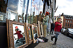 "BRUSSELS - BELGIUM - 07 JANUARY 2012 -- Marolles the bohemian city part of Brussels. -- Painter Antoine Prospero decorating the window of the ""Mirror"" shop on Place de la Chapelle for the sales, his daughter Alice entertaining him with dances in front of the mirrors -- PHOTO: Juha ROININEN /  EUP-IMAGES"