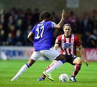 Lincoln City's Aaron Lewis vies for possession with Everton's Alex Iwobi<br /> <br /> Photographer Andrew Vaughan/CameraSport<br /> <br /> The Carabao Cup Second Round - Lincoln City v Everton - Wednesday 28th August 2019 - Sincil Bank - Lincoln<br />  <br /> World Copyright © 2019 CameraSport. All rights reserved. 43 Linden Ave. Countesthorpe. Leicester. England. LE8 5PG - Tel: +44 (0) 116 277 4147 - admin@camerasport.com - www.camerasport.com