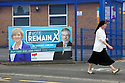 A nun walks past a 'Vote Remain' poster fixed to a school in west Belfast, County Antrim, Thursday, June 23rd, 2016, as voting got under way for the EU referendum on wether the United Kingdom should remain a member of the European Union or Leave the European Union.