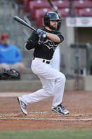 Quad Cities River Bandits left fielder Ross Adolph (9) swings at a pitch against the Cedar Rapids Kernels at Veterans Memorial Stadium on April 15, 2019 in Cedar Rapids, Iowa.  The River Bandits won 7-2.  (Dennis Hubbard/Four Seam Images)