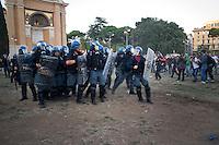 Un momento degli scontri tra manifestanti e polizia in Piazza San Giovanni.<br /> Riots in Saint John square during the &quot;Occupy wall street&quot; demonstration in Rome