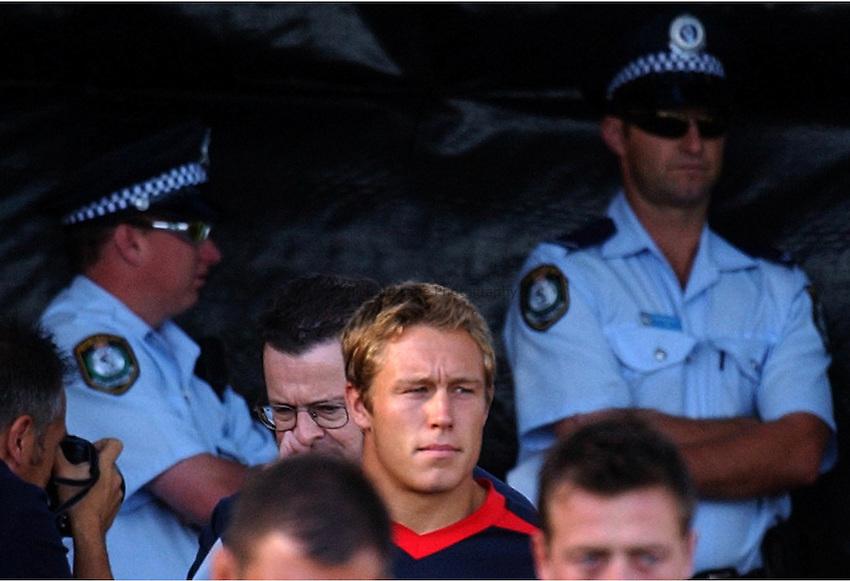 Photo. Steve Holland. England Team training at Brookvale oval, Sydney. RWC 2003..19/11/2003..Jonny Wilkinson arrives with policeman watching on