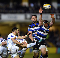 Nic White of Exeter Chiefs box-kicks the ball as Henry Thomas of Bath Rugby looks to charge him down. Aviva Premiership match, between Bath Rugby and Exeter Chiefs on March 23, 2018 at the Recreation Ground in Bath, England. Photo by: Patrick Khachfe / Onside Images