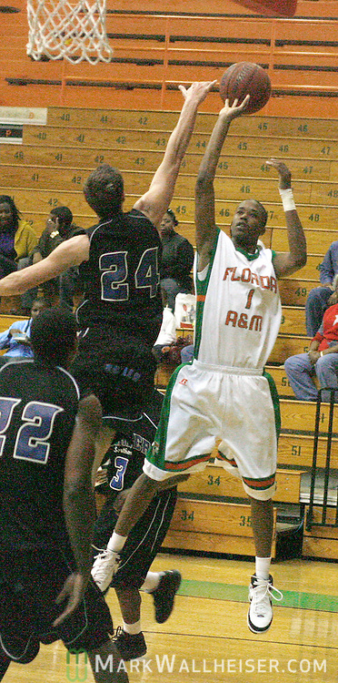 Warner Southern College's Christ Brach (24) blocks FAMU's Jon Mason's shot in the second half at Gaither Gym January 5, 2008.    (Mark Wallheiser/TallahasseeStock.com)