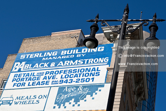 Advertisement for retail and professional Portage avenue location for lease is pictured on the Sterling building in Winnipeg Wednesday May 25, 2011.