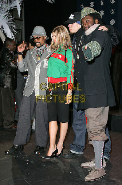BLACK EYED PEAS - TABOO, WILL.I.AM, FERGIE & APL.DE.AP.The 47th Annual Grammy Award Nominees Announcements. The announcements were held at The Music Box in Hollywood, California .December 7th, 2004.full length, three quarter length trousers, green zip up top, pointing, gesture, thumbs up, trousers rolled up.www.capitalpictures.com.sales@capitalpictures.com.Supplied By Capital PIctures