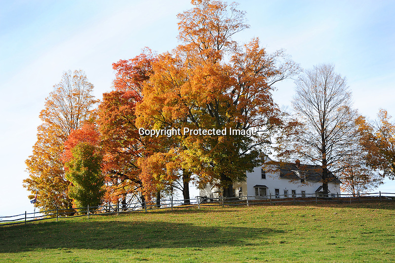 Hilltop Farm with Colorful Foliage during Fall Season in Walpole, New Hampshire USA