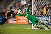 Conor Casey (6) of the Philadelphia Union scores off a header as Columbus Crew goalkeeper Andy Gruenebaum (30) dives for the ball during a Major League Soccer (MLS) match at PPL Park in Chester, PA, on June 5, 2013.